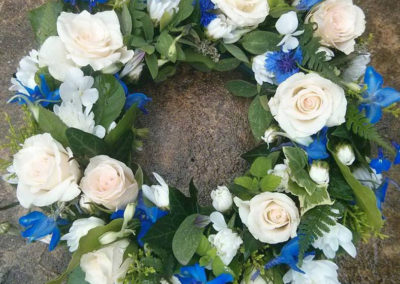 Blue and white circular flower wreath