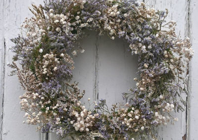 Bella Poppy Flower Design, Chichester - Flowers, Florist,Weddings, Funerals, Dried Flowers, Bouquets - A circular Wreath made of a mix of white and mauve dried flowers