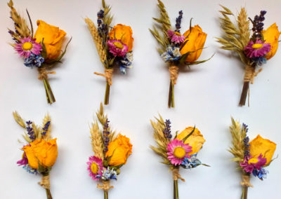 Bella Poppy Flower Design-Chichester-Flowers-Florist-Weddings-Funerals-Bouquets- Flatlay of orange dried flower buttonholes