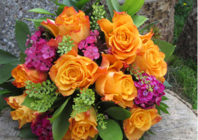 Bella Poppy Flower Design-Chichester-Flowers-Florist-Weddings-Funerals-Bouquets- Orange and pick bridal bouquet 500x500