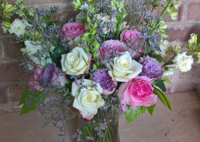 Bella Poppy Flower Design-Chichester-Flowers-Florist-Weddings-Funerals-Bouquets- Vase of white and pink roses 500x500