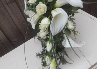Bella Poppy Flower Design-Chichester-Flowers-Florist-Weddings-Funerals-Bouquets - White wedding bouquet made of Lillies and white roses