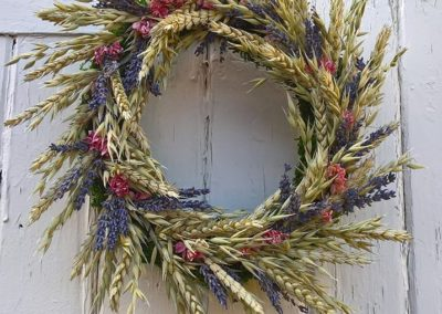 Bella Poppy Flower Design-Chichester-Flowers-Florist-Weddings-Funerals-Bouquets- lavendar and wheat circular wreath