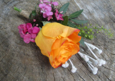 Bella Poppy Flower Design-Chichester-Flowers-Florist-Weddings-Funerals-Bouquets- orange rose buttonhole