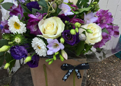 Bella Poppy Flower Design-Chichester-Flowers-Florist-Weddings-Funerals-Bouquets- white rose purple lisianthus freesia blackberry in bag 600x800