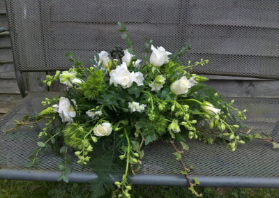 Bella Poppy Flower Design-Chichester-Flowers-Florist-Weddings-Funerals- Funeral flowers in white with ivy