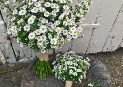Three white daisy hand tied bouquets