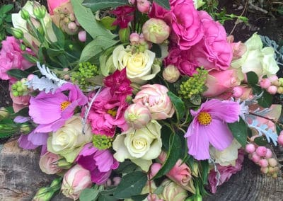Bouquet of pink lisianthus, cosmos and cream roses - wedding flowers