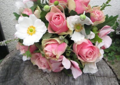 Buoquet of pink rose, jap and anemone flowers