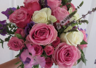 Bouquet of pink roses, sweat pea and mint - wedding flowers