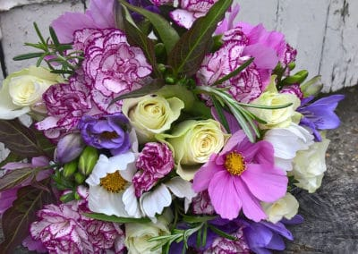 Bouquet of purple freesia cosmos and cream roses - wedding flowers