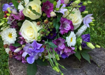 Bouquet of purple sweet peas and white roses - wedding flowers