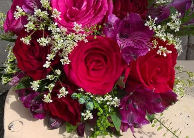 Bouquet of red and pink roses - wedding flowers