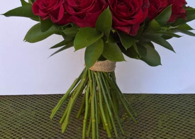 Bouquet of red roses and ruscus - wedding flowers
