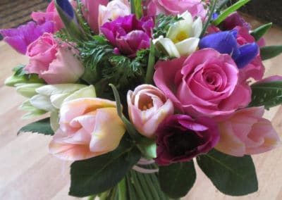 Bouquet of spring tulips, iris and roses - wedding flowers