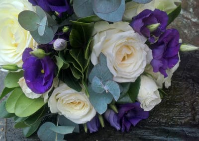 bouquet of white roses and purple lisianthus - wedding flowers