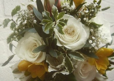 Bella Poppy Flower Design-Chichester-Flowers-Florist-Weddings-Funerals-Bouquets-bridal bouquet yellow freesia white roses