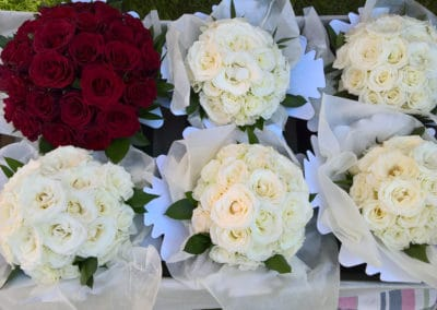 Red and white rose bridesmaid boutquets - wedding flowers