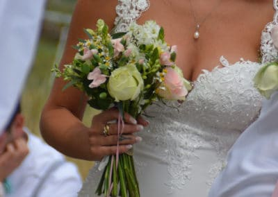 Bride on her wedding day holding a mix bouquet