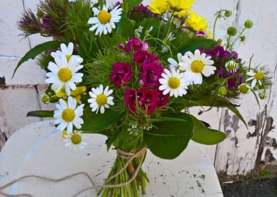 Brides bouquet of garden flowers including daisies - wedding flowers