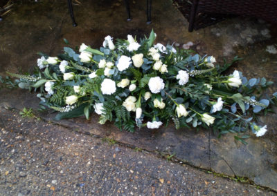Casket spray of white flowers - funeral flowers