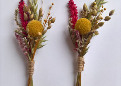 Buttonhole of craspedia and red wheat - dried flowers