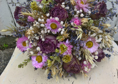 Purpe roses and pink acrol dried flowers