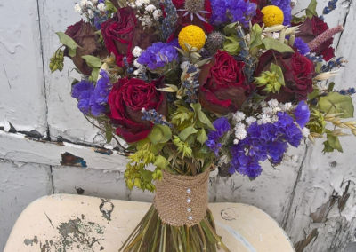 Bouquet of red roses and purple statice and yellow flowers - dried flowers