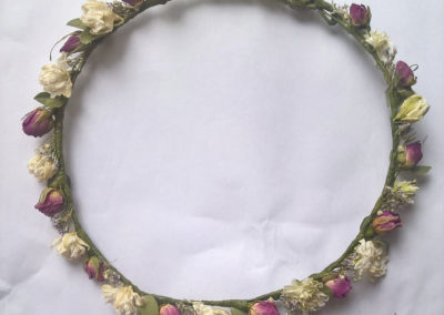 Crown of pink roses and delp - dried flowers