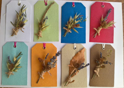 Gift tags of coloured dried flowers