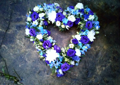Blue and white flower heart shaped wreath - funeral flowers