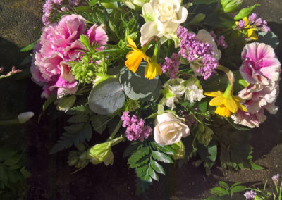 Posy of pink carnations and narcissi - funeral flowers