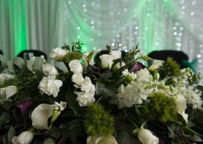 Table top of white roses and green flowers - wedding flowers