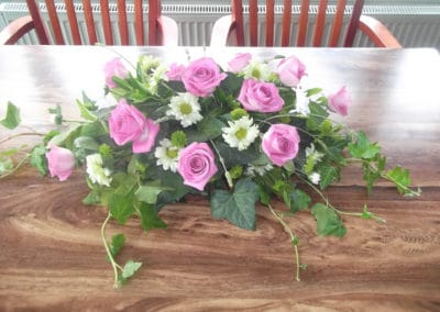 Top Table flower arrangement of pink roses and daisies - wedding flowers