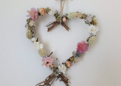 Heart shaped wreath of delp acro phal dried flowers