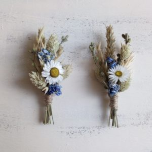 2 buttonholes made of daisies and wheat - wedding flowers